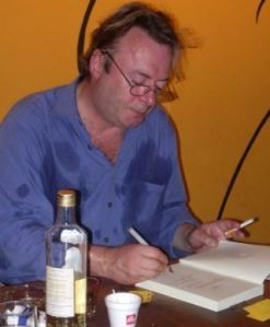 Atheist Christopher Hitchens Signing A Copy Of His Book God Is Not Great For God