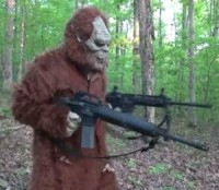 Big Foot Posing With Weapons