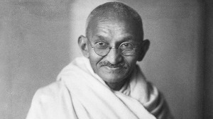 Please Remember To Extinguish Your Cigarettes Before Filling Your Auto With Fuel.  Should The Lit Cigarette Come Into Contact With The Gasoline, A Horrible Explosion Could Result.  Thank You.   Mahatma Gandhi, circa 1942