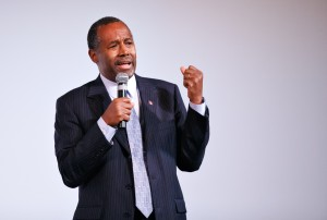 "Ben Carson says, ""The Earth is only 6 days old. I know this is true because I'm a Christian, a neuroscientist, and I read the Bible, and I'm really, really, really smart. If you don't agree with me just come on over here, and I'll punch your liberal ass right in the nose!"""
